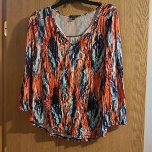 Patterned blouse with tassels
